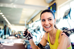 Attractive fit woman in a gym taking a break Stock Images