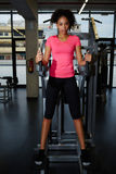 Attractive fit woman in pink t-shirt having a rest after workout at gym Royalty Free Stock Photography