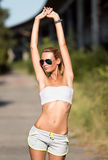 Attractive fit woman in sportswear training outdoors. Female athlete with perfect body Stock Photo