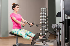 Attractive fit woman training her back in the gym Royalty Free Stock Photography