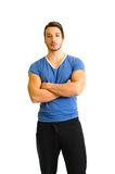 Attractive and fit young man standing, arms crossed Stock Photography