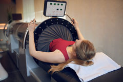 Attractive fit young woman doing vacuum therapy royalty free stock photography