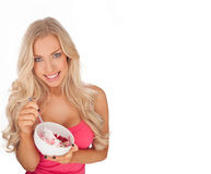 Attractive fit young woman eating ice cream Royalty Free Stock Photography