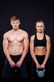 Attractive fitness people holding kettlebells Stock Photography