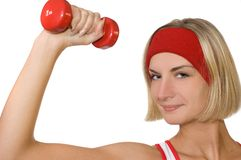 Attractive fitness trainer with a red dumbbell. Picture of an Attractive fitness trainer with a red dumbbell Royalty Free Stock Image