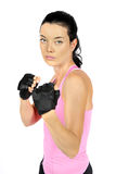 Attractive fitness woman in aggressive pose Royalty Free Stock Photo