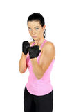 Attractive fitness woman in aggressive pose Stock Images
