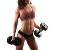 Attractive fitness woman with dumbbells Royalty Free Stock Image
