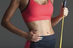 Young fitness woman. Closeup body shot royalty free stock photos