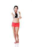 Woman in sport clothes ready for handshake Stock Photo
