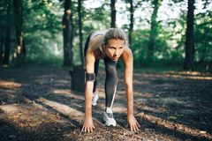 Attractive fitness woman. Workout outdoors stock image