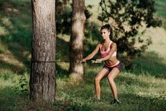 Attractive fitness young woman exercising with resistance band oudoor. Attractive fitness young woman exercising with resistance band oudoor Royalty Free Stock Photo
