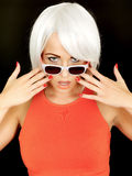 Attractive Flustered Young Woman Wearing Sunglasses Royalty Free Stock Photos