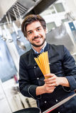 Attractive friendly chef preparing spaghetti Stock Photography