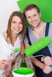 Attractive friendly young couple redecorating Royalty Free Stock Photos