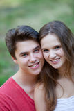 Attractive friendly young teenage couple Stock Image