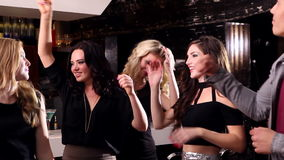 Attractive friends dancing together on the dance floor stock video footage