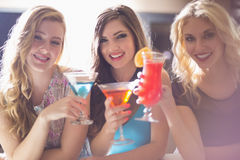 Attractive friends drinking cocktails together Royalty Free Stock Photos