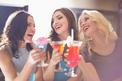 Attractive friends drinking cocktails together Royalty Free Stock Photo