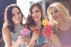 Attractive friends drinking cocktails together Stock Image