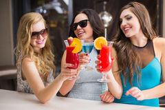 Attractive friends drinking cocktails together Stock Photo