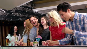 Attractive friends drinking shots together stock footage