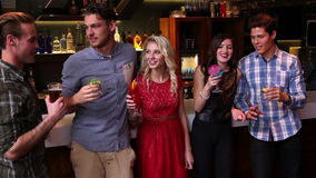 Attractive friends talking and drinking at the bar stock video footage