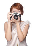 Attractive funny girl with a camera over white. Background Royalty Free Stock Images
