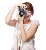 Attractive funny girl with a camera over white. Background Royalty Free Stock Photography