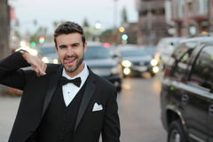 Attractive and funny man going to a party in the city.  Stock Images