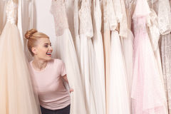 Attractive future bride is choosing white gown Stock Photo