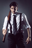Attractive gangster with shotgun Stock Photography