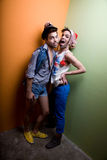 Attractive gay couple in funky clothing Stock Image