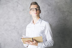 Attractive gentleman with notepad. Attractive white gentleman with spiral notepad in hand. Paper work concept Stock Photo