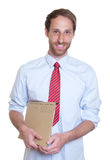 Attractive german businessman with file Stock Photo