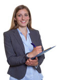 Attractive german businesswoman with clipboard Royalty Free Stock Photography