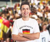 Attractive german fan with dark hair with other fans Stock Image
