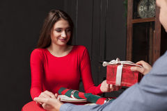 Attractive gift to a beautiful woman in restaurant Stock Photos