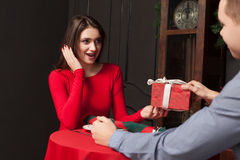 Attractive gift to a beautiful woman in restaurant Stock Image
