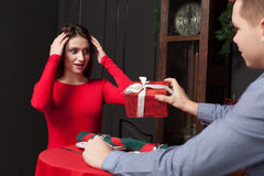 Attractive gift to a beautiful woman in restaurant Royalty Free Stock Photography