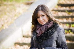 Attractive girl. Cute brunette girl in park Royalty Free Stock Photography