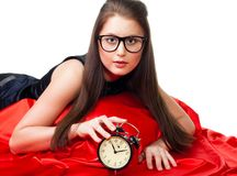 Attractive girl with alarm clock Royalty Free Stock Photo