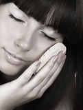 Attractive girl applying face pack Royalty Free Stock Images