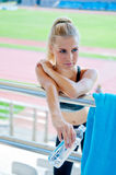 Attractive girl athlete with water bottle Stock Photos