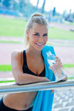 Attractive girl athlete with water bottle Royalty Free Stock Photos