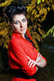 Attractive girl in the autumn park. Young attractive girl in red shirt and with makeup close-up portrait in autumn park Stock Photos