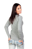Attractive girl on back with hands in pocket royalty free stock image