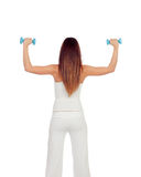 Attractive girl back in white toning her muscles Royalty Free Stock Photography