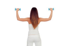 Attractive girl back in white toning her muscles Stock Images