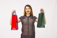Attractive girl with bags Royalty Free Stock Photography